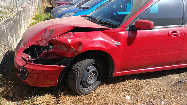 A Red Accident Car